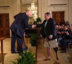 President Trump shakes hands with retired U.S. Army Sgt. Michael Verardo, during the President's remarks in the East Room of the White House, prior to signing the Department of Veterans Affairs Accountability and Whistleblower Protection Act of 2017. (Courtesy: The White House)