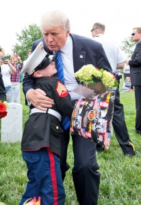 President Trump hugs Christian Jacobs, 6, at the grave of his father in Section 60 of Arlington National Cemetery in Arlington, VA on May 29. Christian joins his mother, Brittany, every year for Memorial Day. (U.S. Army photo by Elizabeth Fraser/Arlington National Cemetery/released)